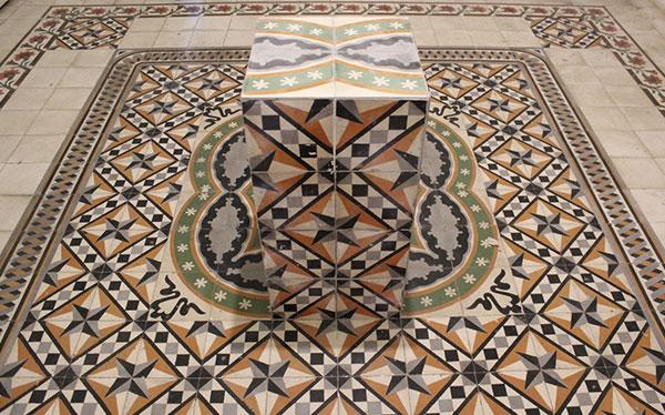 mosiac box sitting on mosaic tile floor