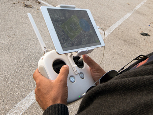 image of person holding controller for drone