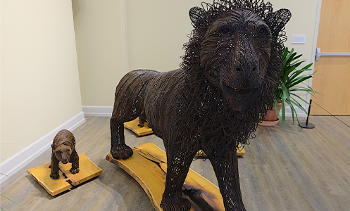 A lion and bear cub sculpture made from metal from poaching traps