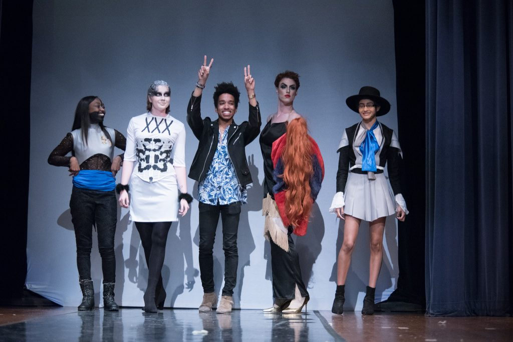 A group of five people on a runway
