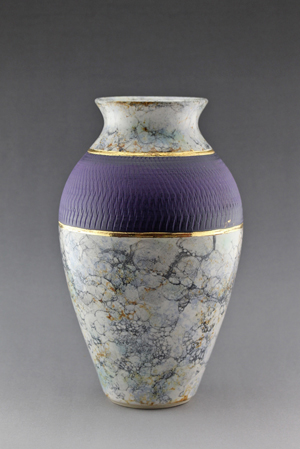 A vase with marble and purple color