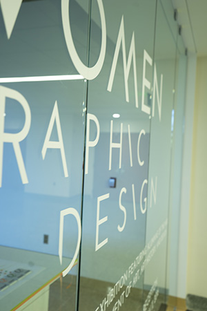 """Glass wall with the words """"Women in Graphic Design"""""""