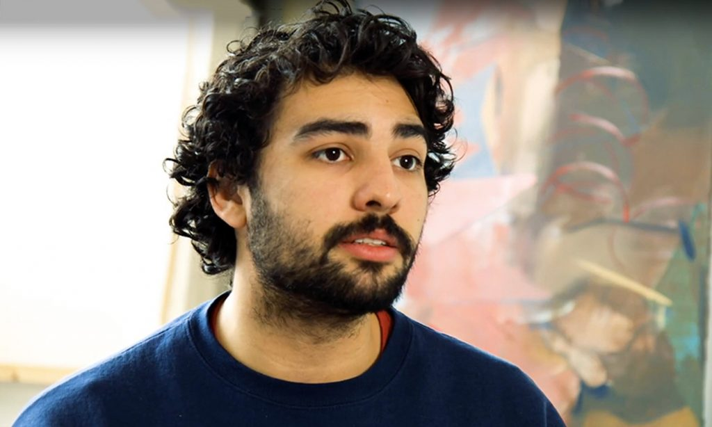 Young man with beard and curly hair