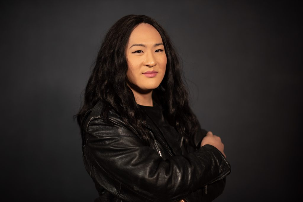 woman wearing a black leather jacket